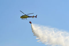 Suppression of the fires by means of the helicopter. Royalty Free Stock Photography
