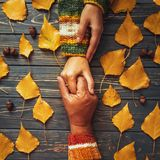 Suppurt and trust. Autumn couple embrace hands top view,fall ash. Leaf,Autumnal relationship family love concept Stock Photography