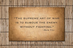The supreme art of war - Sun Tzu. The supreme art of war is to subdue the enemy without fighting. Sun Tzu's quote over bamboo royalty free stock photo