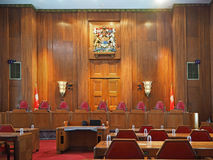 Supreme Court of Canada. OTTAWA - JUNE 2017: The Supreme Court of Canada is housed in an art deco building with seats for each of the nine judges as seen in stock image