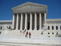 Supreme Court With People Walking Up Steps Stock Photo