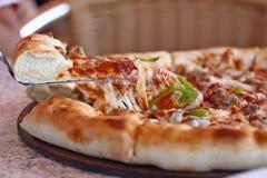 Supreme italian pizza with pepperoni. Fresh supreme italian pizza with cheesy board royalty free stock photos