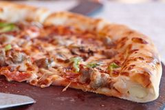 Supreme italian pizza with pepperoni. Fresh supreme italian pizza with cheesy board royalty free stock images