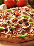 Supreme italian pizza with pepperoni and toppings Stock Images