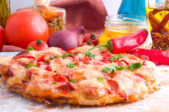 Supreme Pizza. And red tomato stock photos