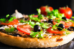 Supreme pizza with cheese tomato pepper and olives Royalty Free Stock Images