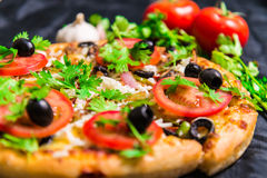 Supreme pizza with cheese tomato pepper and olives Stock Images