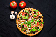 Supreme pizza with cheese tomato pepper and olives Royalty Free Stock Image