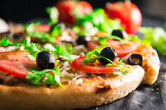 Supreme pizza with cheese tomato pepper and olives Royalty Free Stock Photos