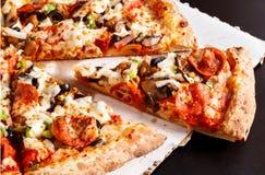 Supreme Pizza. Closeup of a Supreme Pizza royalty free stock photo