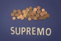 Supremo written with wooden letters on a blue background. To mean a business concept Royalty Free Stock Images