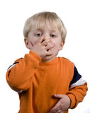 Suprise Boy. Young boy with his hand over his mouth Stock Photo