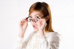Suprise female businesswoman. Business looking woman with spectacles with a exaggerated surprise expression Stock Photos
