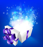 Suprise magical gift. A glowing magical gift box concept for an exciting birthday, Christmas or other gift or present Stock Photos