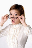 Suprise spectacles woman. Business looking woman with spectacles with a exaggerated surprise expression Royalty Free Stock Photo