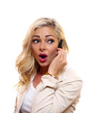 Suprise!. A woman has a surprised look on her face while talking on the cell phone stock images