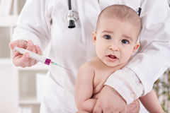 Suprised baby needs to receive vaccine Royalty Free Stock Photography