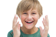 Suprised blonde boy with hands up smiling Royalty Free Stock Photography