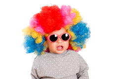 Suprised child. With clown wig and sunglasses isolated on white Royalty Free Stock Image