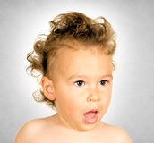 Suprised child. Little suprised child with funny hairstyle Royalty Free Stock Photos