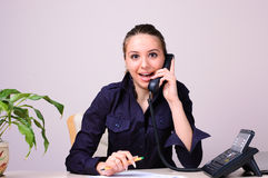 Suprised girl. Sitting in the office Stock Photography