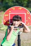 Suprised girl in basketball hoop Stock Photos