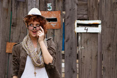 Suprised hipster girl. Interested in something. Who knows what it could be or who Royalty Free Stock Photos
