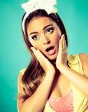 Suprised shocked pin up girl. Stock Image