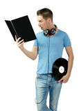 Suprised young deejay holding vinyl and learning Royalty Free Stock Photo
