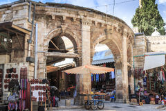 Suq Aftimos, Muristan. Historic entrance to Muristan area of the Jewish Quarter, market stalls and vendors light the street just as in biblical times Royalty Free Stock Photo