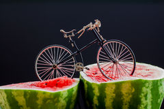 Sur. Bicycle standing on top of ripe watermelon Royalty Free Stock Images