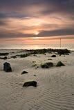 Sur la plage au lever de soleil Photographie stock