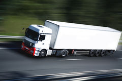 Sur la route. White truck on highway again Royalty Free Stock Photography