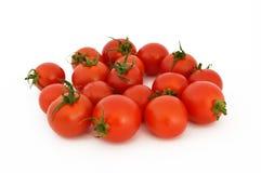 Sur le blanc et la copie espacez les photos courantes saines fraîches de tomates-cerises Photographie stock