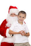 Sur les genoux de Santa Photos stock