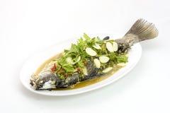 Sur och söt kinesisk mat på vit bakgrund Arkivbild