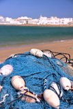SUR, OMAN: A fishing net with the port of Ayjah in the background. A fishing net with the port of Ayjah in the background royalty free stock images
