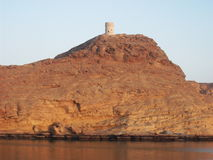 A watchtower at Sur in Oman, Arabian Peninsula. A watchtower in the town of Sur in Oman Royalty Free Stock Photography