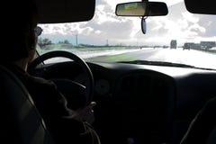 Sur piloter orageux de route Photographie stock