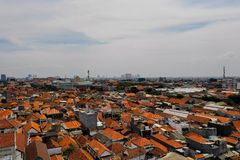 Surabaya capital city east java, indonesia. Aerial cityscape densely built asian city. urban environment in asia. modern city Surabaya with buildings and houses royalty free stock photos