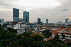 Surabaya capital city east java, indonesia. Aerial cityscape modern city Surabaya with skyscrapers, buildings and houses. sunset in city skyline with skyscrapers royalty free stock image