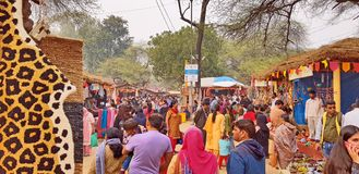 Surajkund Crafts Mela Fair. Surajkund, India - February 14, 2019: Visitors and local people are enjoying and shopping in Surajkund public craft fair in Surajkund royalty free stock photography