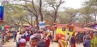 Surajkund Crafts Mela Fair. Surajkund, India - February 14, 2019: Visitors and local people are enjoying and shopping in Surajkund public craft fair in Surajkund stock photo