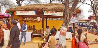 Surajkund Crafts Mela Fair. Surajkund, India - February 14, 2019: Visitors and local people are enjoying and shopping in Surajkund public craft fair in Surajkund stock photography