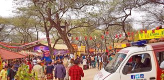 Surajkund Crafts Mela Fair. Surajkund, India - February 14, 2019: Visitors and local people are enjoying and shopping in Surajkund public craft fair in Surajkund stock photos