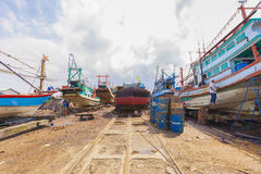 Surat Thani, Thailand - January 15, 2015: Workers and Fishing bo Stock Photography