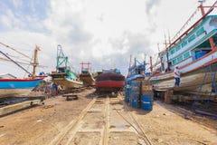 Surat Thani, Thailand - January 15, 2015: Workers and Fishing bo. At at shipyard, Surat thani THAILAND on January 15. -( Selective Focus Stock Photography