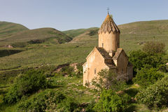 Surb Karapet church over green hills. Armenian ancient church of Surb Karapet in spring Stock Image