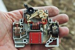 Surcharge électrique de disjoncteur brûlée Images stock