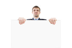 Sure, evil business man showing blank signboard Stock Images